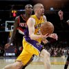 Los Angeles Lakers guard Steve Blake drives to the basket around Portland Trail Blazers guard Jamal Crawford during the first half on an NBA basketball game, Monday, Feb. 20, 2012, in Los Angeles. (AP Photo/Bret Hartman)