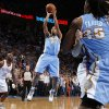 Denver\'s Andre Miller (24) puts up a shoot beside Oklahoma City\'s Reggie Jackson (15) during an NBA basketball game between the Oklahoma City Thunder and the Denver Nuggets at Chesapeake Energy Arena in Oklahoma City, Tuesday, March 19, 2013. Denver won 114-104. Photo by Bryan Terry, The Oklahoman