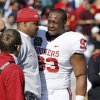Gerald McCoy reacts as Ardrian Taylor (86) is injured during the first half of the Brut Sun Bowl college football game between the University of Oklahoma Sooners (OU) and the Stanford University Cardinal on Thursday, Dec. 31, 2009, in El Paso, Tex. Photo by Steve Sisney, The Oklahoman
