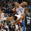 Oklahoma City\'s Russell Westbrook (0) has the ball knocked away as he is fouled by Orlando\'s Jameer Nelson (14) during the NBA basketball game between the Orlando Magic and Oklahoma City Thunder in Oklahoma City, Thursday, January 13, 2011. Oklahoma City won, 125-124. Photo by Nate Billings, The Oklahoman