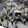 Photo - FILE - In this April 15, 2013 file photo, medical workers aid injured people at the finish line of the 2013 Boston Marathon following an explosion in Boston.  A federal grand jury in Boston returned a 30-count indictment against bombing suspect Dzhokhar Tsarnaev on Thursday, June 27, 2013, on charges including using a weapon of mass destruction and bombing a place of public use, resulting in death. (AP Photo/Charles Krupa, File)