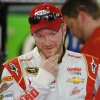 Photo - Dale Earnhardt Jr. looks over his car during practice for Sunday's NASCAR Sprint Cup series Coca-Cola 600 auto race at Charlotte Motor Speedway in Concord, N.C., Saturday, May 24, 2014. (AP Photo/Chris Keane)