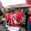 Photo - Carmalita Johnson drums as protesters participate in a rally outside a McDonald's on Chicago's south side as labor organizers escalate their campaign to unionize the industry's workers Thursday, Sept. 4, 2014. Hundreds of workers from McDonald's, Taco Bell, Wendy's and other fast-food chains are expected to walk off their jobs Thursday, according to labor organizers of the latest national protest to push the companies to pay their employees at least $15 an hour.  (AP Photo/M. Spencer Green)