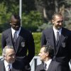 Photo - Italy forward Mario Balotelli, background left, flanked by his teammate Giorgio Chiellini, speak with Italy coach, Cesare Prandelli, foreground right, and Giancarlo Abete, president of the Italian Soccer Federation, at the Coverciano center, near Florence, Italy, Tuesday, June 3, 2014. (AP Photo/Fabrizio Giovannozzi)