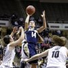 Photo - Akron guard Hanna Luburgh (14) shoots over Purdue guard Courtney Moses, left, and guard Hayden Hamby during the first half of a first-round game in the NCAA women's college basketball tournament, Saturday, March 22, 2014, in West Lafayette, Ind. (AP Photo/Michael Conroy)