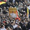 Crowds gather in St. Peter\'s Square for the inauguration of Pope Francis at the Vatican, Tuesday, March 19, 2013. (AP Photo/Gregorio Borgia)