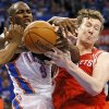 Oklahoma City\'s Serge Ibaka (9) and Houston\'s Omer Asik (3) battle for a rebound during Game 1 in the first round of the NBA playoffs between the Oklahoma City Thunder and the Houston Rockets at Chesapeake Energy Arena in Oklahoma City, Sunday, April 21, 2013. Oklahoma City won, 120-91. Photo by Nate Billings, The Oklahoman