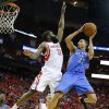 Oklahoma City\'s Kevin Martin (23) goes drives to the basket beside Houston\'s James Harden (13) during Game 6 in the first round of the NBA playoffs between the Oklahoma City Thunder and the Houston Rockets at the Toyota Center in Houston, Texas, Friday, May 3, 2013. Photo by Bryan Terry, The Oklahoman
