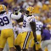 Photo -   LSU defensive end Lavar Edwards (89) and defensive tackle Bennie Logan (18) celebrate a sack during the first half of an NCAA college football game against Washington in Baton Rouge, La., Saturday, Sept. 8, 2012. LSU won 41-3. (AP Photo/Gerald Herbert)