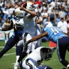 Photo -   San Diego Chargers quarterback Philip Rivers, center, throws under pressure from Tennessee Titans defensive end Derrick Morgan, right, during the first quarter of an NFL football game, Sunday, Sept. 16, 2012, in San Diego. (AP Photo/Denis Poroy)