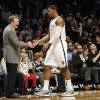Brooklyn Nets interim head coach P.J. Carlesimo shakes hands with Joe Johnson (7) as he comes off the court in the second half of an NBA basketball game against the Phoenix Suns on Friday, Jan., 11, 2013 at Barclays Center in New York. Johnson scored 19 points in the Nets 99-79 win. (AP Photo/Kathy Kmonicek)