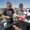 Greg Briggs, left, and Ty Brooks cook meats to raise money for the Mustang High School Band Boosters during the Mustang Western Days celebration in Mustang, OK, Saturday, September 8, 2012, By Paul Hellstern, The Oklahoman