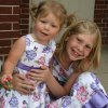 Brynn and Zoey McDowell, from left, show off their matching dresses for grandmother Charlotte Buchan, who is a resident of Touchmark at Coffee Creek. The Touchmark community and the Coffee Creek Homeowners Association co-sponsored an Easter egg hunt, whic