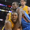 Los Angeles Lakers forward Metta World Peace, left, ties up the ball with Oklahoma City Thunder forward Serge Ibaka of Congo during the second half in Game 4 of an NBA basketball playoffs Western Conference semifinal, Saturday, May 19, 2012, in Los Angeles. The Thunder won 103-100. (AP Photo/Mark J. Terrill)