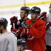 New Jersey Devils right wing Steve Bernier (18) stands with teammates as they listen to head coach Peter DeBoer talk to them during the team\'s first official practice since the NHL hockey lockout ended, Sunday, Jan. 13, 2013, in Newark, N.J. (AP Photo/Julio Cortez)