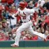St. Louis Cardinals\' Allen Craig heads to second on a two-run double during the fourth inning of a baseball game against the Milwaukee Brewers, Wednesday, April 30, 2014, in St. Louis. (AP Photo/Jeff Roberson)