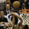Miami Heat\'s Chris Bosh (1) is defended by San Antonio Spurs\' Manu Ginobili (20), of Argentina, during the first half at Game 4 of the NBA Finals basketball series, Thursday, June 13, 2013, in San Antonio. (AP Photo/David J. Phillip)