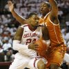 Photo - Oklahoma's Romero Osby (24) drives to the basket against Texas' Jonathan Holmes (10) during a men's college basketball game between the University of Oklahoma (OU) and the University of Texas at the Lloyd Noble Center in Norman, Okla., Monday, Jan. 21, 2013. Photo by Nate Billings, The Oklahoman