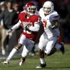 Oklahoma\'s Jalen Saunders (18) runs past Oklahoma State\'s Shamiel Gary (7) after a reception in the Bedlam college football game between the University of Oklahoma Sooners (OU) and the Oklahoma State University Cowboys (OSU) at Gaylord Family-Oklahoma Memorial Stadium in Norman, Okla., Saturday, Nov. 24, 2012. Oklahoma won 51-48. Photo by Bryan Terry, The Oklahoman