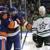 Photo - New York Islanders' Josh Bailey (12) hugs Peter Regin (16) as Dallas Stars' Alex Chiasson (12) reacts after Regin scored in the second period of an NHL hockey game on Monday, Jan. 6, 2014, in Uniondale, N.Y. (AP Photo/Kathy Kmonicek)
