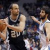 Photo - Minnesota Timberwolves' Ricky Rubio, from Spain, guards San Antonio Spurs guard Manu Ginobili (20), from Argentina during the second quarter in an NBA basketball game at the Target Center on in Minneapolis on Tuesday, April 8, 2014. (AP Photo/Hannah Foslien)