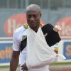 Photo - Cameroon's Webo Achille leaves the stadium after getting injured during their friendly soccer match against Macedonia in Kufstein, Austrian province of Tyrol, on Monday, May 26. 2014. (AP Photo/Kerstin Joensson)
