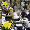 Photo -   Chicago Bears cornerback Tim Jennings (26) breaks up a pass intended for Green Bay Packers wide receiver Jordy Nelson (87) during the first half of an NFL football game Thursday, Sept. 13, 2012, in Green Bay, Wis. (AP Photo/Morry Gash)