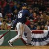 Photo - Milwaukee Brewers' Khris Davis watches his double against the Boston Red Sox during the eleventh inning of a baseball game at Fenway Park in Boston, Saturday, April 5, 2014. (AP Photo/Winslow Townson)