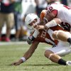 Oklahoma\'s Ronnell Lewis (56) forces a fumble on Texas quarterback David Ash (14) during the Red River Rivalry college football game between the University of Oklahoma Sooners (OU) and the University of Texas Longhorns (UT) at the Cotton Bowl in Dallas, Saturday, Oct. 8, 2011. Photo by Chris Landsberger, The Oklahoman