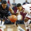 TCU\'s Nate Butler Lind (21) and Oklahoma\'s Isaiah Cousins (11) chase a loose ball during an NCAA men\'s basketball game between the University of Oklahoma (OU) and Texas Christian University (TCU) at the Lloyd Noble Center in Norman, Okla., Monday, Feb. 11, 2013. Photo by Nate Billings, The Oklahoman