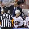 Photo - Columbus Blue Jackets head coach Todd Richards, center, talks with referee Tom Kowai (32) in the second period of a hockey game against the Florida Panthers, Saturday, April 12, 2014, in Sunrise, Fla. Seated are Cam Atkinson (13) and Matt Calvert (11).  The Blue Jackets defeated the Panthers 3-2. (AP Photo/Lynne Sladky)