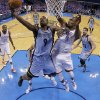 Oklahoma City\'s Serge Ibaka (9) defends against Memphis\' Tony Allen (9) during Game 7 in the first round of the NBA playoffs between the Oklahoma City Thunder and the Memphis Grizzlies at Chesapeake Energy Arena in Oklahoma City, Saturday, May 3, 2014. Photo by Sarah Phipps, The Oklahoman