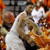 Texas\' Sheldon McClellan (1) tries to get past Oklahoma State\'s Le\'Bryan Nash (2) during an NCAA college basketball game between Oklahoma State University (OSU) and the University of Texas (UT) at Gallagher-Iba Arena in Stillwater, Okla., Saturday, Feb. 18, 2012. Oklahoma State won 90-78. Photo by Bryan Terry, The Oklahoman