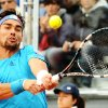Photo - Italy's Fabio Fognini returns the ball to Britain's James Ward, during their Davis Cup World Group quarterfinal match in Naples, Italy, Friday April 4, 2014. (AP Photo/Salvatore Laporta)