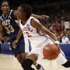 Danielle Robinson dribble past Xenia Stewart in the first half of the NCAA women\'s basketball tournament game between the University of Oklahoma and Pittsburgh at the Ford Center in Oklahoma City, Okla. on Sunday, March 29, 2009. PHOTO BY STEVE SISNEY, THE OKLAHOMAN