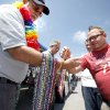 Dustin Hooten gets beads from Stephen Melsh with the First Unitarian Church during the 2012 OKC Pride Festival in downtown Oklahoma City , Saturday, May 19, 2012. Photo by Sarah Phipps, The Oklahoman