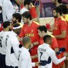 Basketball players for the United States and Spain shake hand before the start of the men\'s gold medal basketball game at the 2012 Summer Olympics, Sunday, Aug. 12, 2012, in London. (AP Photo/Matt Slocum)