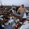 Shannon Steele searches through rubble as he tries to salvage his mother\'s belongings after her home sustained heavy damage Friday, March 2, 2012 in Marysville, Ind. Powerful storms stretching from the Gulf Coast to the Great Lakes flattened buildings in several states, wrecked two Indiana towns and bred anxiety across a wide swath of the country in the second powerful tornado outbreak this week. (AP Photo/The Courier-Journal, Sam Upshaw Jr.) NO SALES; MAGS OUT; NO ARCHIVE; MANDATORY CREDIT ORG XMIT: KYLOC105
