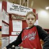 Photo - Sixth-grader Casey Jones, 11, with his science fair project titled