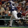Photo - Milwaukee Brewers' Carlos Gomez watches his solo home run during the seventh inning of a baseball game against the St. Louis Cardinals, Tuesday, April 29, 2014, in St. Louis. (AP Photo/Jeff Roberson)
