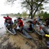 Commuters, unable to use the highway due to raging floodwaters from Typhoon Koppu, ride a boat to get to their destinations in La Paz township, Tarlac province, in northern Philippines Tuesday, Oct. 20, 2015. Slow-moving Typhoon Koppu blew ashore with fierce winds in the northeastern Philippines early Sunday, toppling trees and knocking out power and communications and forcing the evacuation of thousands of villagers. (AP Photo/Bullit Marquez)