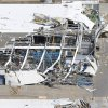 An aerial view shows the damage to Spirit Aerosystems from Saturday\'s tornado in Wichita, Kan., Sunday, April, 15, 2012. The massive storm system that plowed through Kansas this weekend damaged businesses, uprooted trees, caused power outages and upended about 100 homes in a Wichita mobile home park. But no serious injuries or fatalities were reported, which one authority called