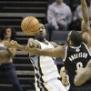 Photo - Memphis Grizzlies' Tony Allen, left, passes the ball in front of Brooklyn Nets' Alan Anderson in the first half of an NBA basketball game in Memphis, Tenn., Saturday, Nov. 30, 2013. (AP Photo/Danny Johnston)