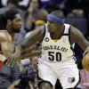 Photo - Memphis Grizzlies' Zach Randolph (50) works the ball around Washington Wizards' Nene, of Brazil, left, during the first half of an NBA basketball game in Memphis, Tenn., Friday, Feb. 1, 2013. (AP Photo/Danny Johnston)