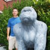 Willie Ng, quarterback of the 1984 state champion Picher Gorillas football team, poses with Picher's mascot statue. Photo by Gary Crow, For The Oklahoman