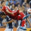 Photo - Toronto FC forward Gilberto (9) plays the ball over Sporting Kansas City defender Igor Juliao, bottom, during the first half of an MLS soccer match in Kansas City, Kan., Friday, May 23, 2014. (AP Photo/Orlin Wagner)