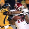 West Virginia\'s Terrell Chestnut (16) breaks up a pass intended for Oklahoma\'s Jaz Reynolds (16) during the first quarter of their NCAA college football game against Oklahoma in Morgantown, W.Va., on Saturday, Nov. 17, 2012. (AP Photo/Christopher Jackson)
