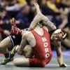 Oklahoma State\'s Jordan Oliver, right, controls Edinboro\'s David Habat during their 149-pound match at the NCAA division I college wrestling championships, Thursday, March 21, 2013, in Des Moines, Iowa. (AP Photo/Charlie Neibergall) ORG XMIT: IACN116