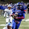Moore\'s Derek Harris scores on a pass reception in the final minute of the first half as the Moore Lions play the Lawton Eisenhower Eagles in a high school football game on Friday, Oct. 5, 2012, in Moore, Okla. Photo by Steve Sisney, The Oklahoman