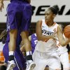 Oklahoma State\'s Kendra Suttles (31) passes the ball around TCU\'s Natalie Ventress (24) during a women\'s college basketball game between Oklahoma State University and TCU at Gallagher-Iba Arena in Stillwater, Okla., Tuesday, Feb. 5, 2013. Oklahoma State won 76-59. Photo by Bryan Terry, The Oklahoman